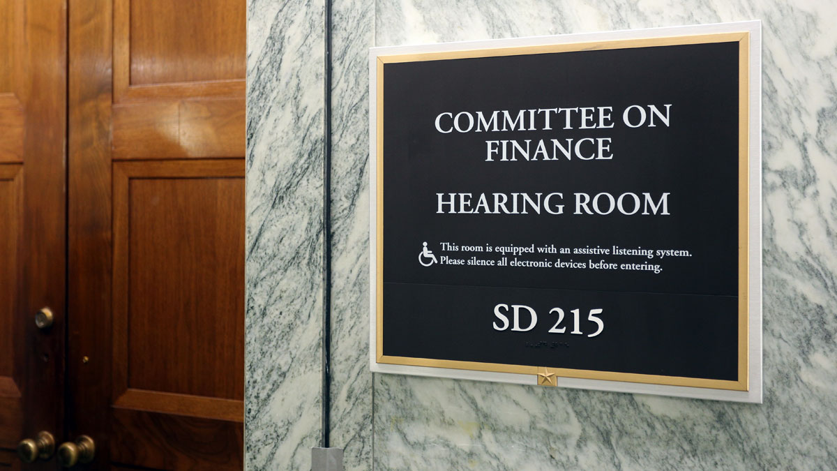 WASHINGTON - JULY 18: A sign at the entrance to a Senate Finance Committee hearing room in Washington, DC on July 18, 2017. The United States Senate is the upper chamber of the United States Congress.