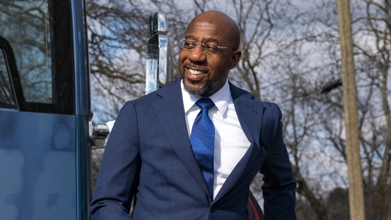 Georgia Democratic Candidate Rev. Raphael Warnock meets with supporters on January 5, 2021 in Marietta, Georgia. Polls have opened across Georgia in the two runoff elections, pitting incumbents Sen. David Perdue (R-GA) and Sen. Kelly Loeffler (R-GA) against Democratic candidates Rev. Raphael Warnock and Jon Ossoff. (Photo by Megan Varner/Getty Images)