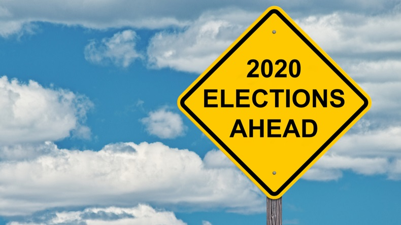 2020 Election Ahead - Caution Sign Blue Sky Background
