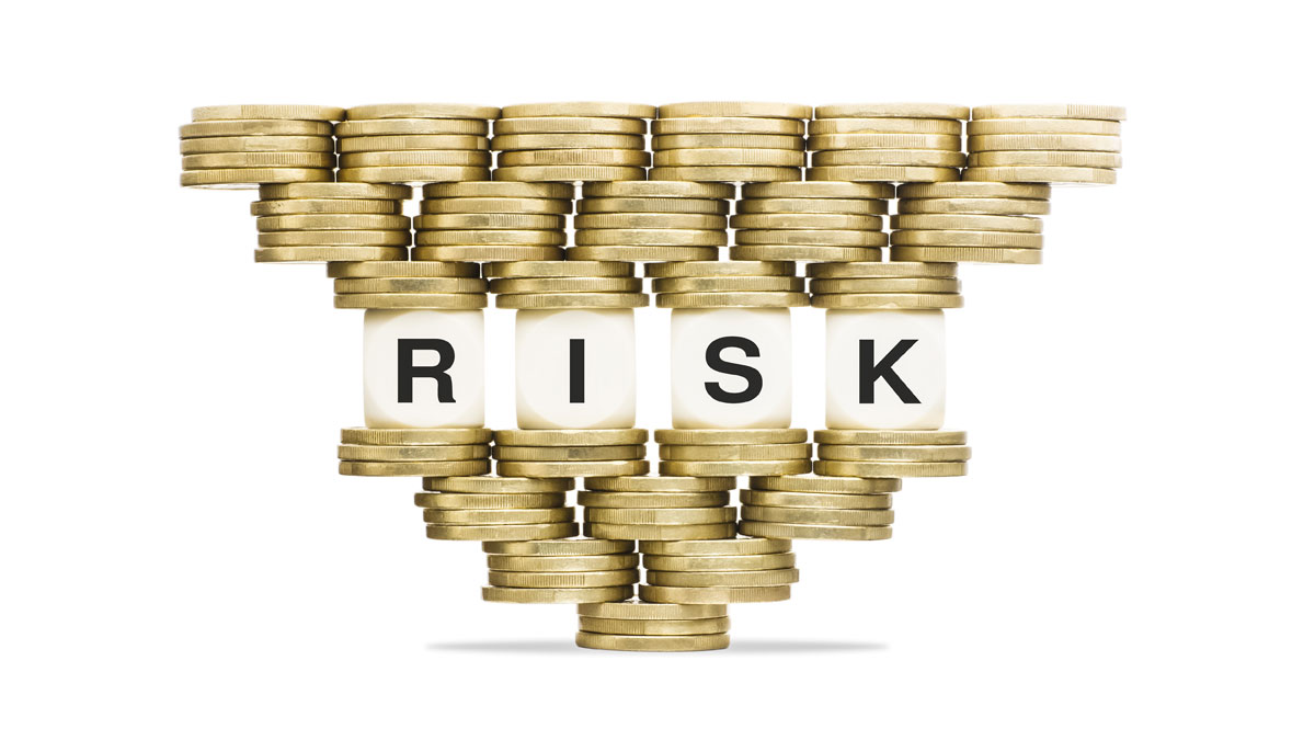 Risk Management Word RISK on Unstable Stack of Gold Coins - Image
