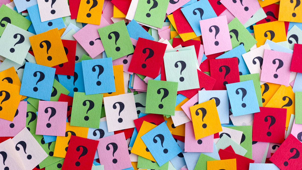 Too Many Questions. Pile of colorful paper notes with question marks. Closeup. - Image