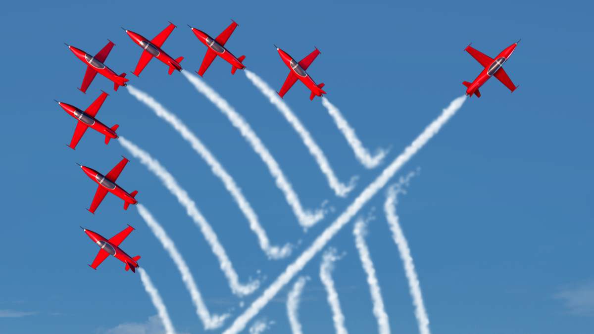 Disruptive innovation Independent leadership concept and individuality as a group of acrobatic jets with one individual jet going in the opposite direction as a business symbol for new thinking. - Illustration