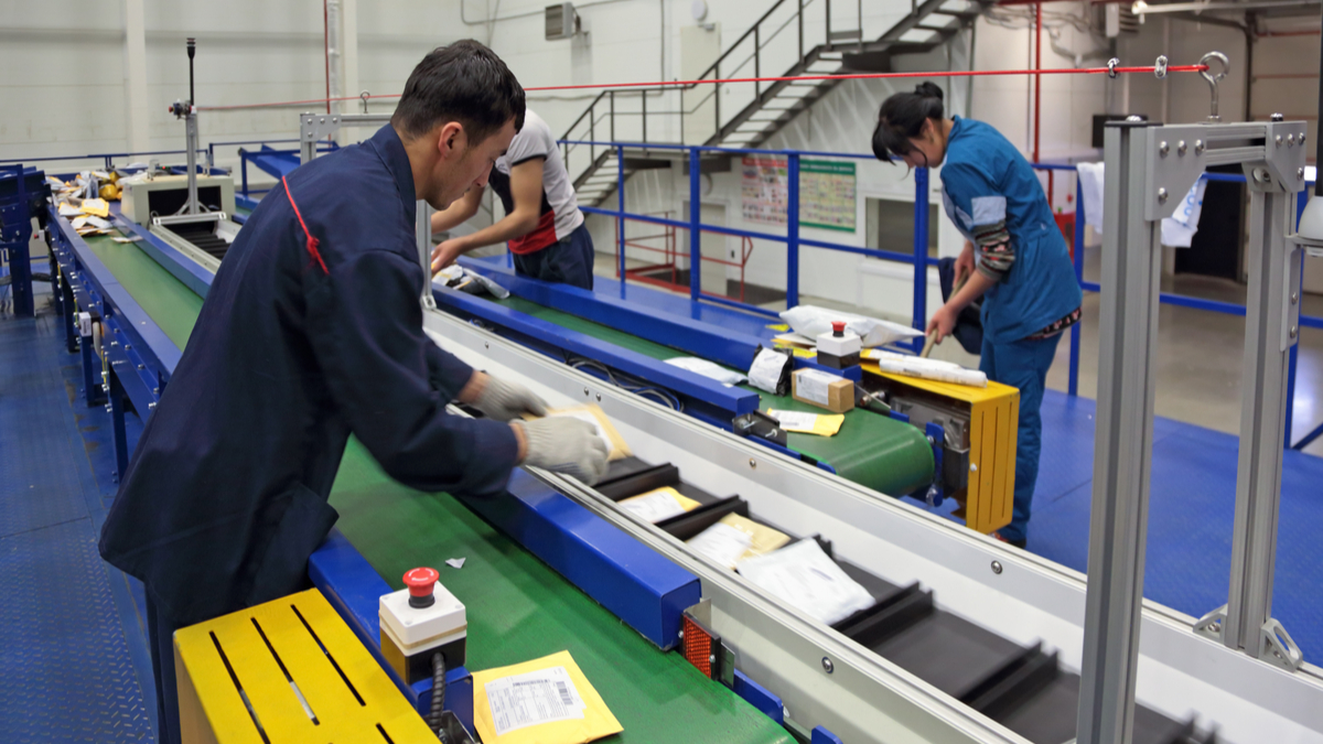 VNUKOVO, MOSCOW REGION, RUSSIA - APR 7, 2015: Russian Post. Logistics center in Vnukovo, working around sorting conveyor