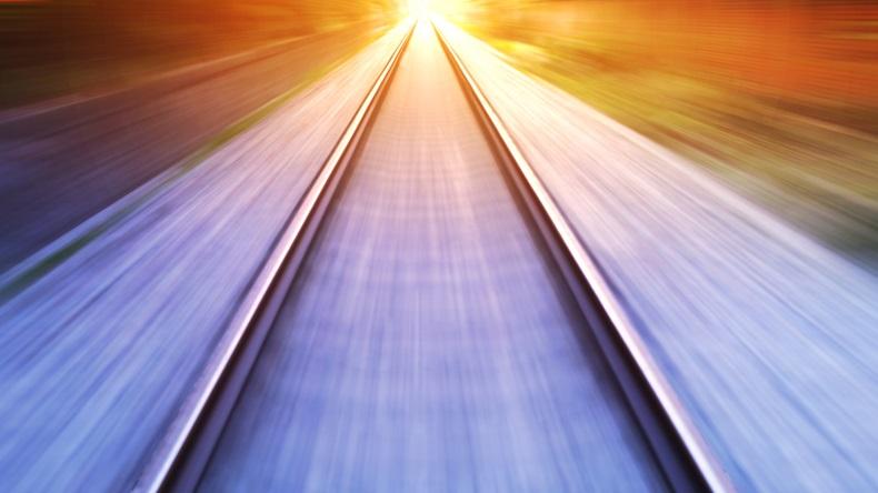 train fast run on railway track in sunny day