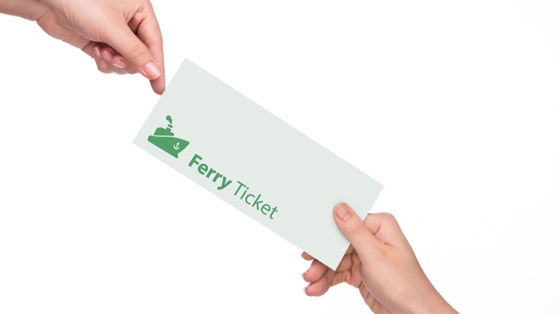 Woman's hand holding a ferry ticket on white background close-up