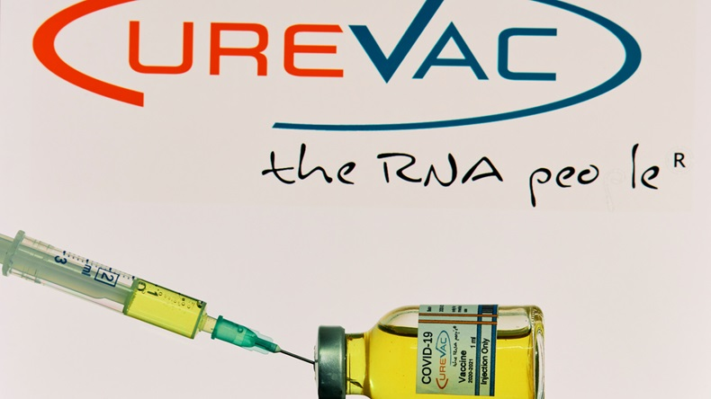 MALLORCA/SPAIN- November 21 2020: CureVac research Coronavirus (Covid 19) vaccine. Row of vaccine bottles with blurred CureVac company logo on background.