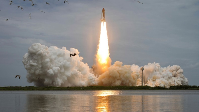 Space shuttle Atlantis lifts off from the Kennedy Space Center, Florida