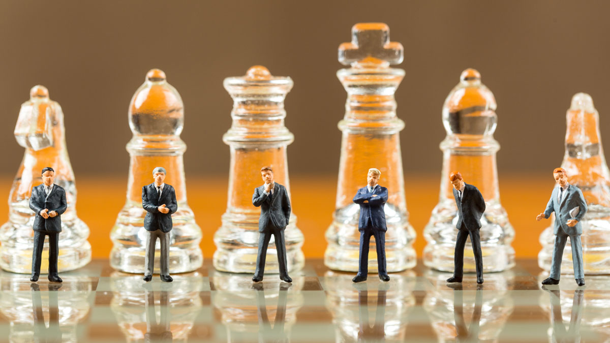 Business men on a Chess board