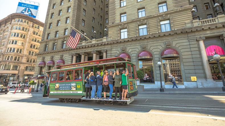 San Francisco, California, United States - August 17, 2016: The Cable Car of San Francisco full of tourists in front of luxurious Westin St. Francis hotel, along the famous Powell Street. - Image