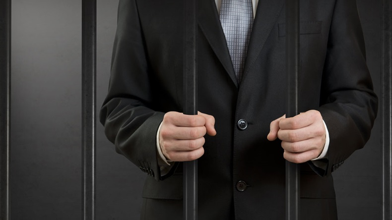 BusinessmanBehindBars_1200-x-675