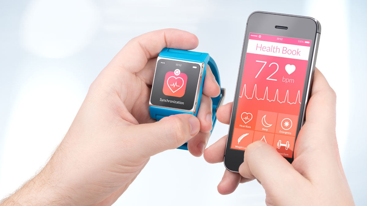 Data synchronization of health book between smartwatch and smartphone in male hands