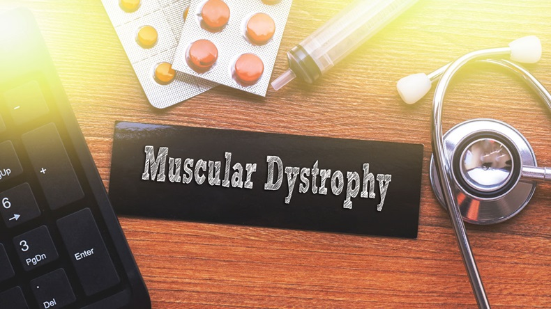MUSCULAR DYSTROPHY words written on label tag with medicine,syringe,keyboard and stethoscope