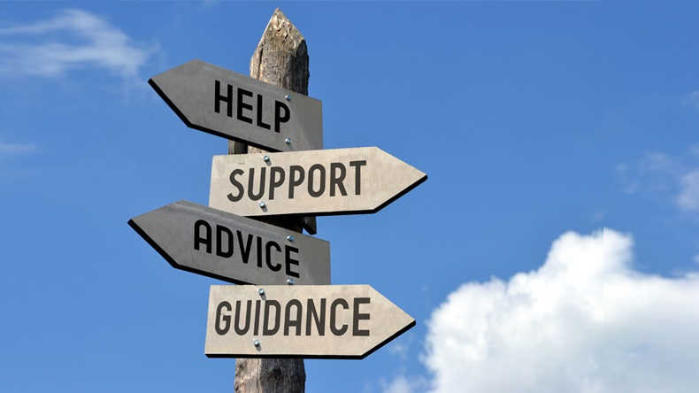"Wooden signpost with four arrows - ""help, support, advice, guidance"". Great for topics like customer support, assistance, business presentations etc."