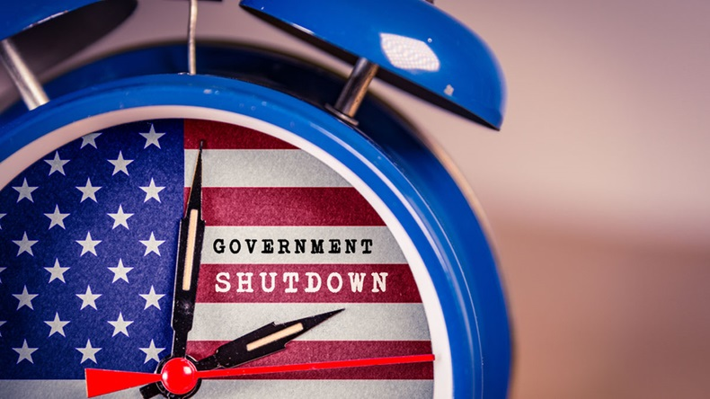 Retro alarm Clock with Government Shutdown text,and American Flag. USA shutdown, government closed and American federal shut down due to spending bill disagreement between the left and the right - Image