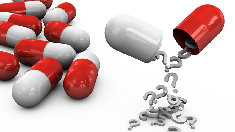 3d different tablets and pills on a white background with question marks