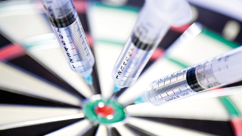 Syringes stuck in a dartboard